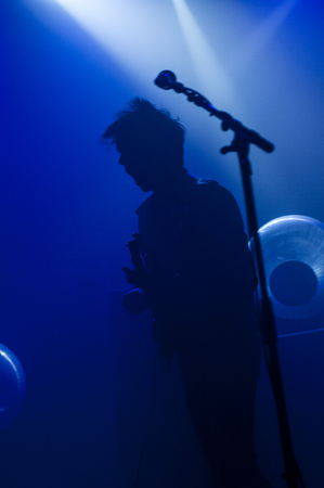 Silhouette of a rock band members playing live Editorial