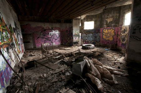 Inside an abandoned WWII casemate with graffiti on the French Atlantic coast.