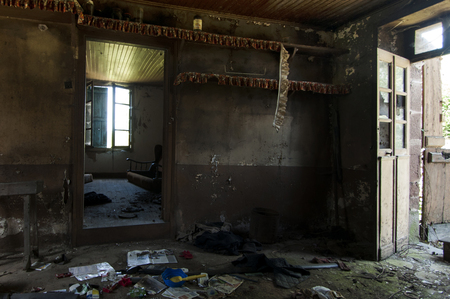Messy living room of an abandoned French farm