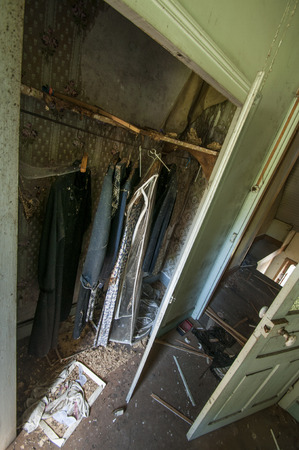 Clothes closet in an abandoned French farm Imagens