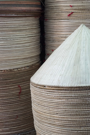 Traditional Vietnamese conical hats are presented at Binh Tay market in Ho Chi Minh City, Vietnam