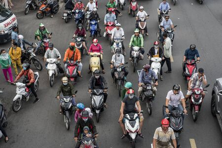 Vietnamese bike riders commute in a jammed street of Ho Chi Minh City