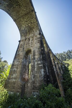 The Nine Arch bridge seen from the tea plantation under it at Ella in Sri Lanka. Stock Photo