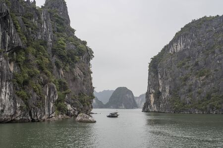 View of Halong Bay with only one small fishing boat