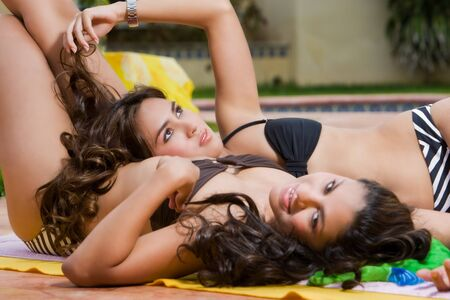 seductive women: Two girls lying close to each other