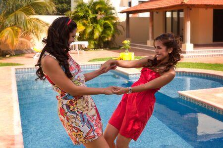 2 Latin girls at the swimming pool