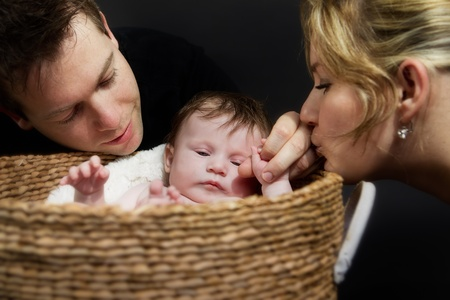 a Baby girl and her proud parents  Stock Photo - 9716013