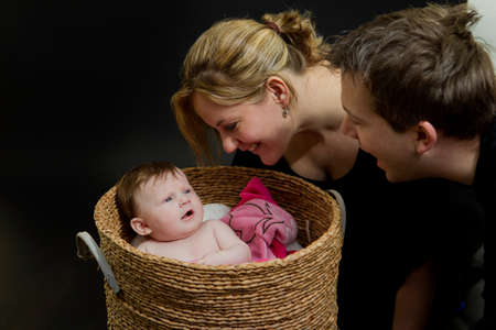 A baby girl in a laundry basket Stock Photo - 9716032