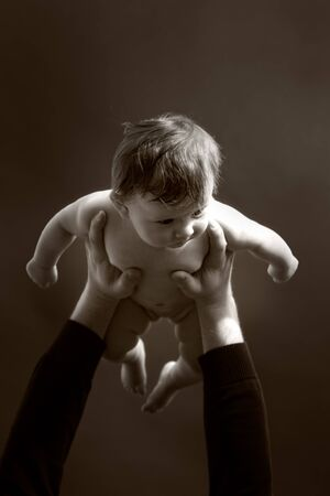 a father lifting up his baby