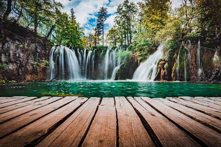 A low perspective looking across at the waterfalls in Plitvice Lakes, Croatia