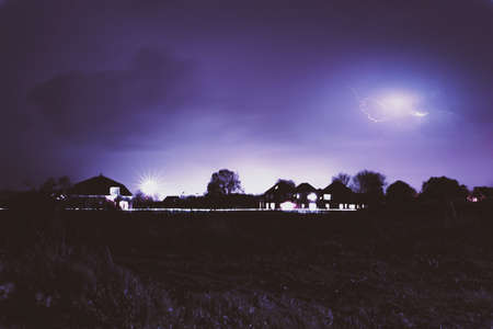 punishing: Lightning in the distant sky Stock Photo