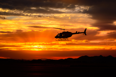 Bell 206 at sunset Banque d'images