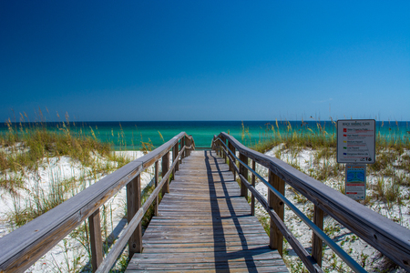 Boardwalk leading to the emerald waters of Pensacola Beach, FL.