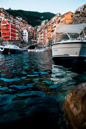 one of the five lands cities riomaggiore photographed from a low angle on the water 版權商用圖片 - 134858738