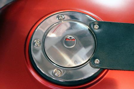 benzin: Fuel Cap of Motorcycle in Red Gas Tank