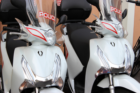 police force: Two Scooters of the National Police Force of Monaco parked in the street in Monaco