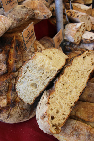 crusty french bread: Golden Ball Bread Campaign Campaign Country Bread in French. Market of Aix-en-Provence, France