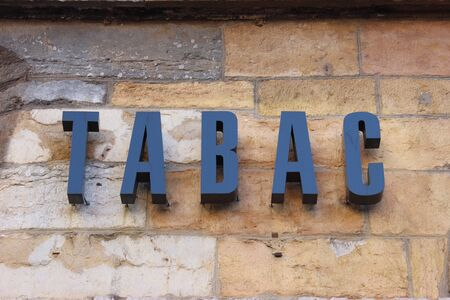 cigar smoke: French Tobacco Sign 3D Letters on the Wall. In France Tobacco means clustering Tobacco