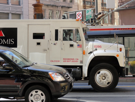 San Francisco, USA - July 23, 2010: An Loomis Armored car, in the streets of San Francisco. Loomis is an International Cash handling company