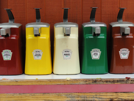 Big Sur, USA - July 24 2010: Heinz Condiments Dispenser Pack in a Fast Food Restaurant. Heinz is an American Food Company