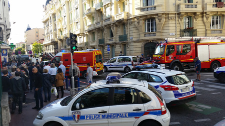 Nice, France - October 16 2015: French Police officers and Firefighters at Building Fire. Emergency Vehicles in the Streets of Nice in French Riviera France Editorial