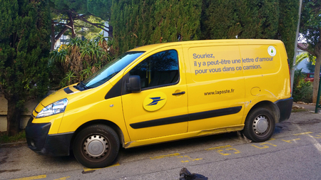 nemo: Roquebrune-Cap-Martin, France - October 30 2015: Yellow Citroen Nemo Combi, Car of the French Post Service La Poste, Parked Waiting to Deliver the Mail in Roquebrune-Cap-Martin, French Riviera