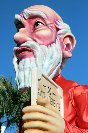 ten commandments: Nice, France - February 21 2016: Caricature of Moses and The Ten Commandments Prophet. Parade Float During the Carnival of Nice Carnival Parade 2016 in French Riviera. The Theme for 2016 Was King of Media