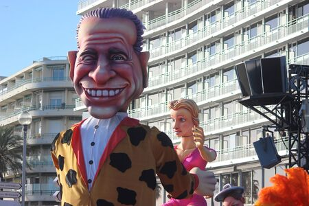 rey caricatura: Nice, France - February 21 2016: Caricature of Silvio Berlusconi Bunga Bunga. Berlusconi is a Businessman and an Italian Politician. Parade Float During the Carnival of Nice Carnival Parade 2016 in French Riviera. The Theme for 2016 Was King of Media