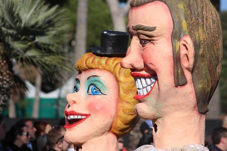 rey caricatura: Nice, France - February 21 2016: Parade Float during the Carnival of Nice (Corso Carnavalesque 2016) in French Riviera. The Theme for 2016 was King of Media Editorial