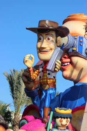 toy story: Nice, France - February 21 2016: Sheriff Woody, cowboy of Toy Story. Parade Float during the Carnival of Nice (Corso Carnavalesque 2016) in French Riviera. The Theme for 2016 was King of Media Editorial