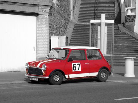 Le Havre, France - May 3 2009:  Mini Cooper Black and White Photography. Red Retro Car Austin Mini Cooper Parked on the Streets of Le Havre in the Normandy region Editorial