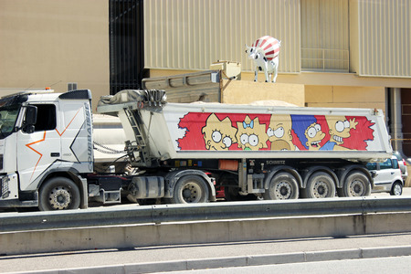 truckload: Fontvieille, Monaco - September 18, 2015: Dump Truck Trailer with characters from the Cartoon The Simpsons. South of France Editorial