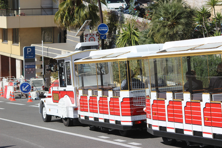 trackless: Monte-Carlo, Monaco - March 9, 2016: Red and White Trackless Train for Sightseeing in Monaco on the Street of Monte-Carlo, Monaco in the south of France Editorial