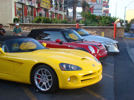 hertz: Las Vegas, USA - July 16 2010: Luxurious and Colorful Cars for Rent Waiting in the Parking Lot of a Supermarket on the Las Vagas Strip, Nevada