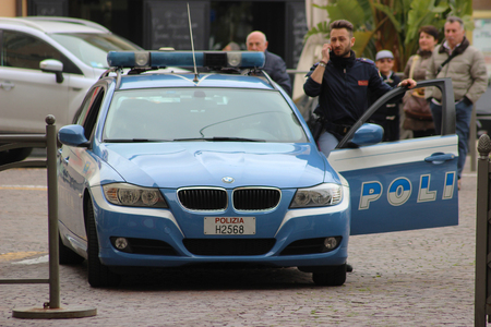sanremo: San Remo, Italy - March 20, 2016: Italian Policeman with a BMW car in the Streets of San Remo. City on the Mediterranean Coast of western Liguria in north-western Italy Editorial