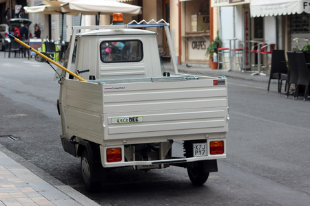 sanremo: San Remo, Italy - March 20, 2016: White Piaggio APE 50 Van Parked in the Streets of San Remo. City on the Mediterranean Coast of western Liguria in north-western Italy
