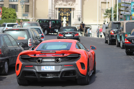 supercar: Monte Carlo, Monaco - April 6, 2016: Red Supercar McLaren 675LT in the Streets of Monaco in Front of The Monte Carlo