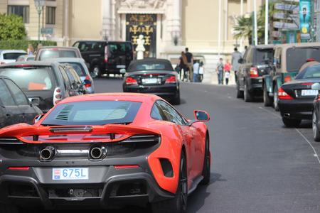 Monte-Carlo, Monaco - April 6, 2016: Red McLaren 675LT Supercar in the Streets of Monaco in Front of The Monte-Carlo Casino