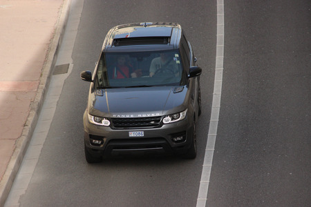 sunroof: Monte-Carlo, Monaco - April 6, 2016: Aerial view of a Land Rover Range Rover Sport SUV in the Streets of Monaco. Man Driving a Black Range Rover Sport in the South of France