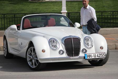 montecarlo: Monte-Carlo, Monaco - April 6, 2016: White Mitsuoka Roadster Parked in Front of the Monte-Carlo Casino in Monaco