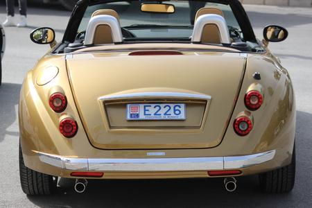 montecarlo: Monte-Carlo, Monaco - April 6, 2016: Golden Mitsuoka Roadster Parked in Front of the Monte-Carlo Casino in Monaco