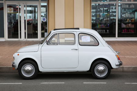 fiat: Menton, France - May 14, 2016: Small Italian car Fiat 500 Parked in a Parking Lot in Menton. Red Fiat 500 F