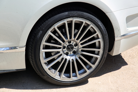 braking: Nice, France - May 15, 2016: Wheel and Braking System Components of a Luxury Continental GT Mansory Parked in Front of the Nice Orthodox Church