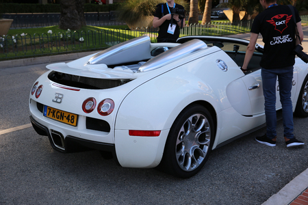 supercar: Monte Carlo, Monaco - May 17, 2016: White Supercar Bugatti Veyron 16.4 Grand Sport (Rear View) Parked in Front of the Grimaldi Forum in Monaco Editorial