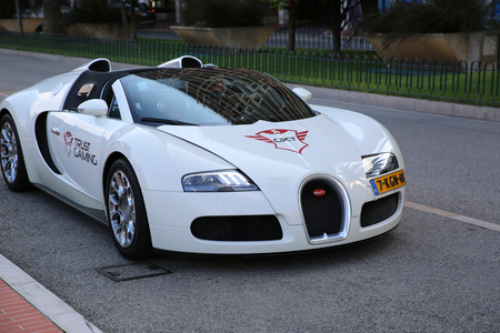 supercar: Monte-Carlo, Monaco - May 17, 2016:  White Supercar Bugatti Veyron 16.4 Grand Sport Parked in Front of the Grimaldi Forum in Monaco