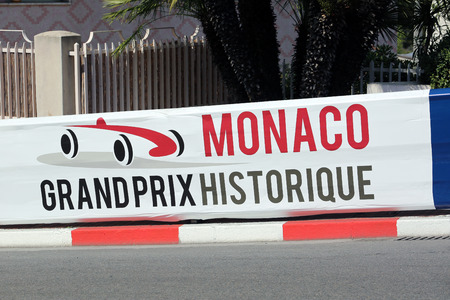 prix: Monte-Carlo, Monaco - May 18, 2016: Red and White Monaco Grand Prix Historique Signboard in Monte-Carlo, Monaco