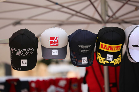 formula one: Monte-Carlo, Monaco - May 28, 2016: Many Different Caps of Famous Formula One Team For Sale During the Monaco Formula 1 Grand Prix 2016