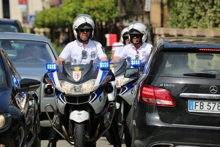 a white police motorcycle: Monte Carlo, Monaco - May 28, 2016: Motorcyclists Police Escort of the Prince of Monaco During the Monaco Formula 1 Grand Prix 2016