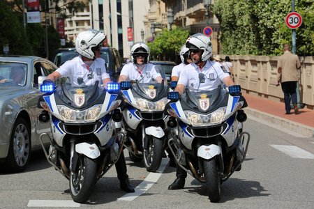 a white police motorcycle: Monte Carlo, Monaco - May 28, 2016: Four Motorcyclists of the Monaco Police During the Monaco Formula 1 Grand Prix 2016