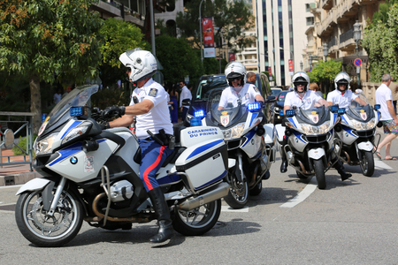 a white police motorcycle: Monte-Carlo, Monaco - May 28, 2016: Four Motorcyclists of the Monaco Police during the Monaco Formula 1 Grand Prix 2016 Editorial